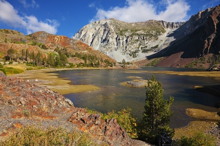 superficial: Picturesque superficial lake on pass Tioga in Yosemite park in the USA. Autumn midday Stock Photo
