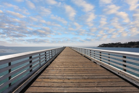 handrails: Wooden pier with handrails. Pacific Coast, California, USA