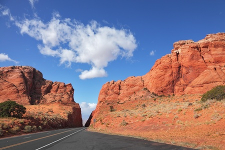 Magnificent American road among rocks of red sandstone