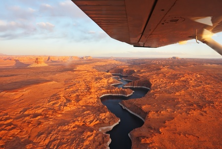 Magnificent lake Powell  and canyon Antelope on a sunset photographed from the plane. Stock Photo - 9954293