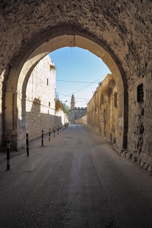 Arch and narrow street in the old quarters of the eternal Jerusalem photo