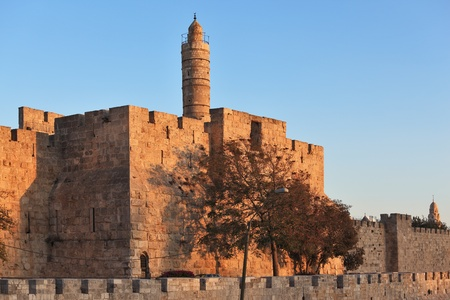 The walls of the eternal Jerusalem. Last rays of the sun gently illuminates the ancient walls and Tower of David photo