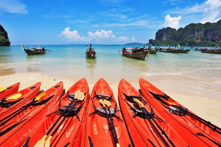 Red modern boats - canoes and boats antique Longtail on a beach in Thailand  photo