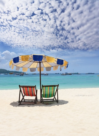Paradise rest on a beach. Elegant beach chaise lounges on a beach of Rajlej near to Krabi, Thailand  photo
