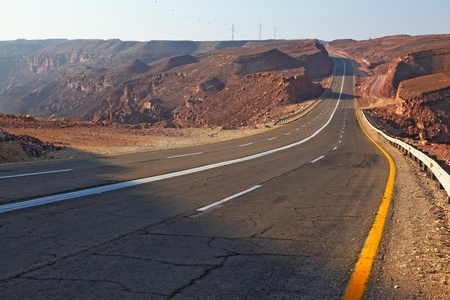Magnificent highway in ancient mountains of Eilat in Israel. A sunset photo