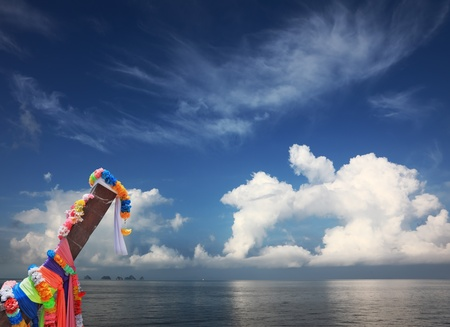Beautifully decorated with colored silks Native Longtayl boat and fancy cloud photo