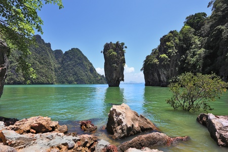 Fabulously beautiful landscape. Lovely island -  rock in the shape of the vaseJames Bond. Closed lagoon into the ocean. photo