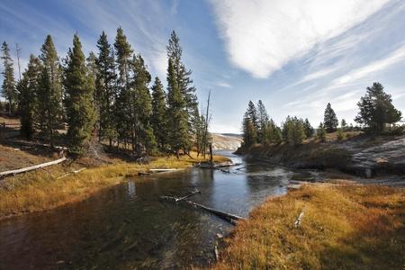 wilderness area: Slow watercourse. Warm autumn day Stock Photo