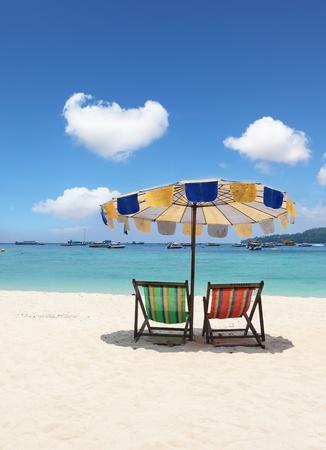 Paradise beach holiday. Elegant beach loungers on the beach near Krabi, Thailand