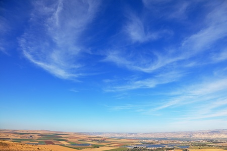 Fields, meadows and villages were photographed from Mount Barkan. Sunset. Blue sky over the Isreel Valley blooming. photo