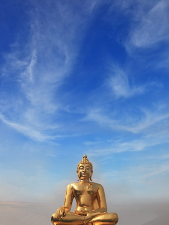 mystic: The famous Golden Triangle. Golden Buddha statue shining in the sun. Place on the Mekong River, which borders three countries - Thailand, Myanmar and Laos. Stock Photo