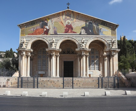 pediment: Church of All Nations in Jerusalem. The magnificent colonnade and the pediment of decorative painting Stock Photo