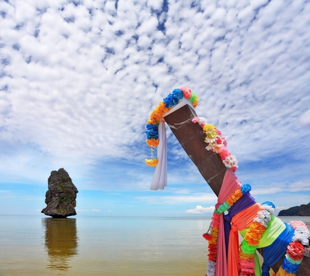 Beautifully decorated with colored silks Native boat Longtail and vertical island photo