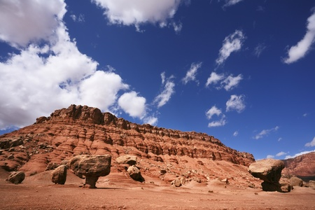giant mushroom: American red rock desert. The famous giant mushroom of red sandstone, glowing clouds, midday shadows