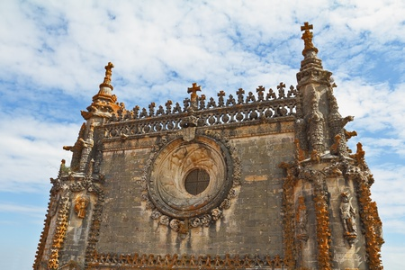 templars: The magnificent medieval monastery Templars in Portugal. A fragment of the facade, decorated in traditional style   Editorial