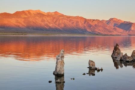 stalagmites: Extremely beautiful landscape. Mono Lake on a sunset. Lake stalagmites of the Tufa are reflected in smooth water of lake Stock Photo