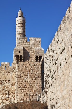 The walls of the eternal Jerusalem. Tower of David on a sunny day. Jerusalem illuminated soft rays sunset photo