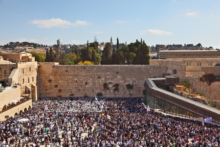 kotel: The most joyful holiday of the Jewish people - Sukkot. The Western Wall of the Jerusalem temple. The area before it is filled up by people on time of a morning prayer