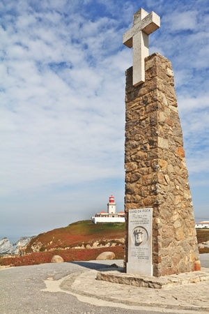 roca: The obelisk with a large white cross. Cabo da Roca - the extreme western point of Europe