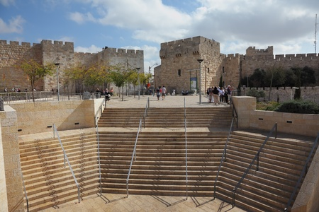 The famous Jaffa Gate in Jerusalem. Tourists on the marble steps in front of Old City photo