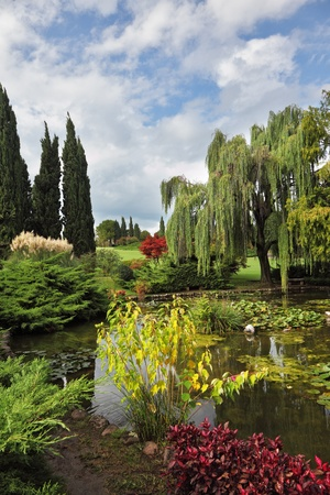 Fabulously beautiful park-garden Sigurta. Ornamental pond and colorful flowers and trees photo
