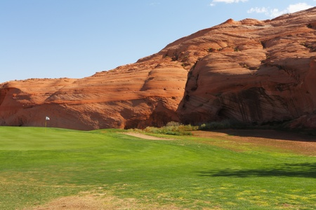 Green lawn and hill from red sandstone. Vicinities of the city of Page in the USA Stock Photo - 12544876