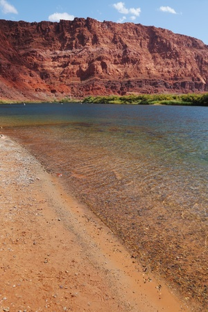 Wild River Colorado. The sandy beach and the steep slope of red sandstone photo