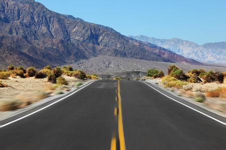 Driving on the highway, crossing Death Valley in the U.S., with high speed photo