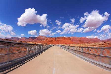 The bridge over the Colorado River and shining light clouds photo