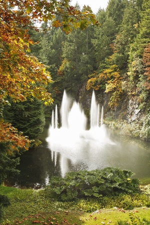 Magnificent dance fountain in well-known Butchard-garden on island Vancouver photo