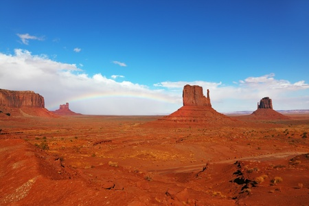 Rainbow in a red desert  The famous  Mittens  in Monument Valley after the rain photo