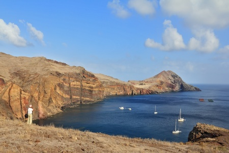 oceanic: The photographer photographs the white yachts in the picturesque bay  Eastern end of the oceanic island of Madeira Stock Photo