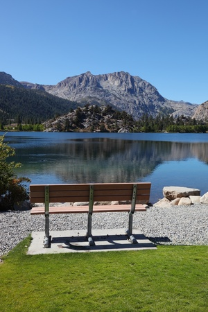 Cosy bench on the shore of Gull Lake. Fine autumn day photo