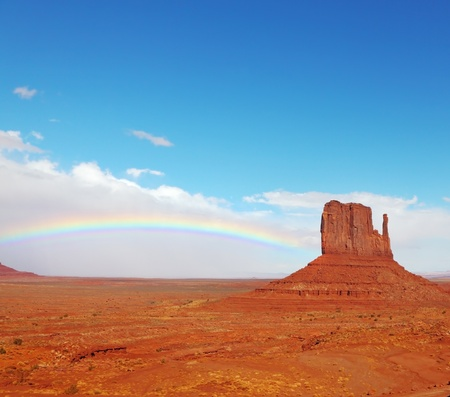 Rainbow in a red desert  Monument Valley in the autumn, after rain photo