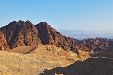 sinai desert: Early morning in ancient mountains of Sinai desert  Sunrise over Red sea