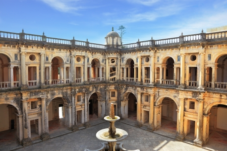templars: Beautifully preserved castle - palace of the Templars. Courtyard surrounded by galleries. In the center - a fountain. Portugal, Tomar