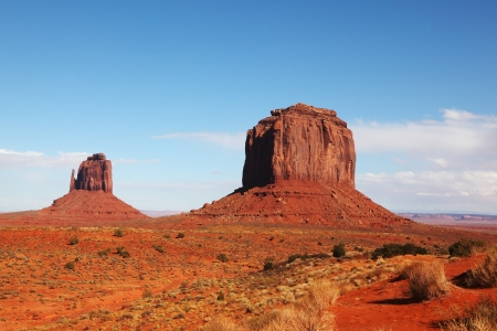 The majestic Monument Valley. Famous bright orange sandstone rock 'Mittens' photo