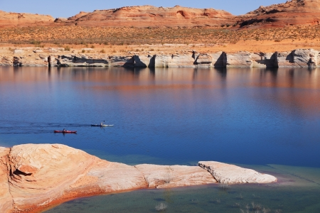 Antelope Canyon in the Navajo Reservation. Two boats with oars float near the water channel Stock Photo - 13813379