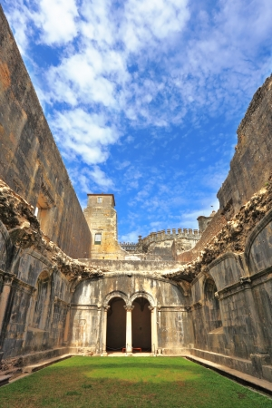 Palace of the Knights Templar in the small town of Tomar, Portugal  Beautiful green inner courtyard, surrounded by a fine building with a beautifully preserved architecture