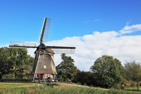 Pastoral landscape in the Netherlands. The windmill on the green hill photo