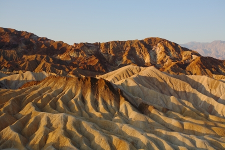 Precise mountain folds well-known a Zabrisky-point in Death valley in the USA. A sunset photo
