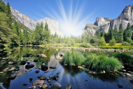 merced: The magnificent Yosemite Valley. The huge granite monolith El Capitan and the shining sun reflected in the smooth waters of the river Mersed