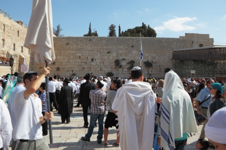 Jerusalem - October 16: The Holy Western Wall of the Temple. Thousands of Jews in traditional religious garb came to pray in the square in front of the Wailing Wall in Sukkot, October 16, 2011 in Jerusalem, Israel Stock Photo - 15319492
