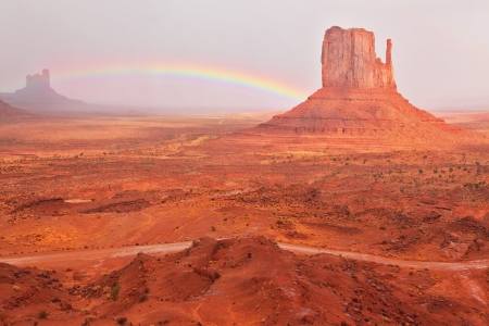grandiose: Grandiose and magnificent Valley of Monuments after a thunder-storm. Bright red Mitts are connected by a shining rainbow