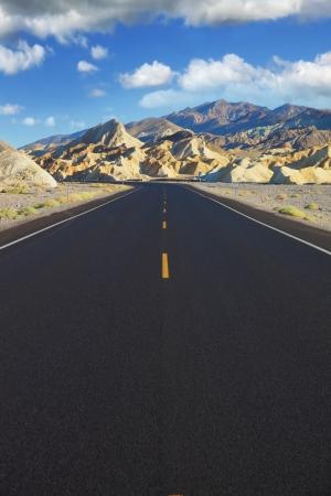 Excellent road in the desert. Black asphalt with an orange road markings photo