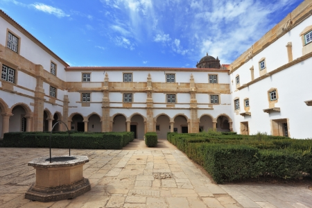 templars: Palace of the Knights Templar in the small town of Tomar, Portugal  Beautiful green inner courtyard, surrounded by a fine building with a beautifully preserved architecture