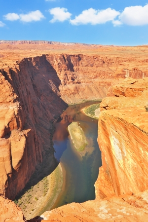 The well-known river Colorado is picturesquely bent in the Horseshoe  The high and abrupt coast dangerously breaks over green water of the river Stock Photo - 16311562