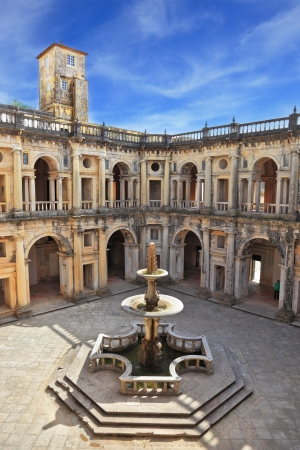 templars: Beautifully preserved castle - palace of the Templars. Courtyard surrounded by galleries. In the center - a fountain with a pool in the shape of a cross. Portugal, Tomar