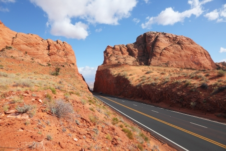 Magnificent American road among rocks of red sandstone photo