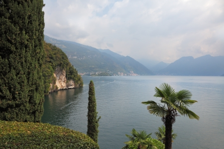 Lake Como in the misty haze  Magnificent park on the shore - Villa Balbianella photo